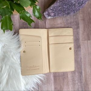 Glass Laddder & Co peach passport clutch